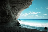 Beach cave with blue water and sky